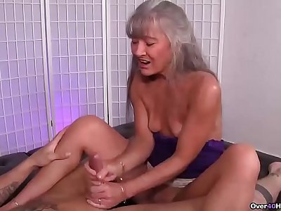 ov40-Mature slut jerking a young man