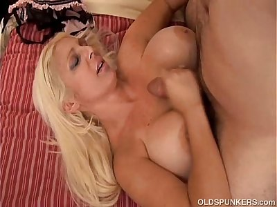 Beautiful big tits MILF fucks a lucky younger guy